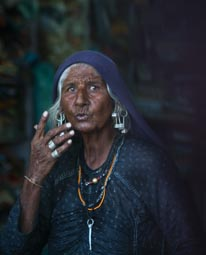 an elderly woman with silver jewelry portrait
