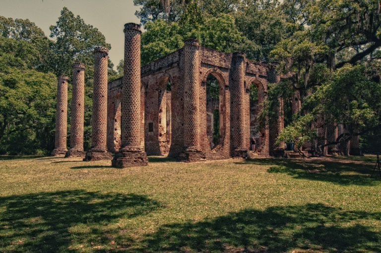 Brick columns of Sheldon Church surrounded by live oaks