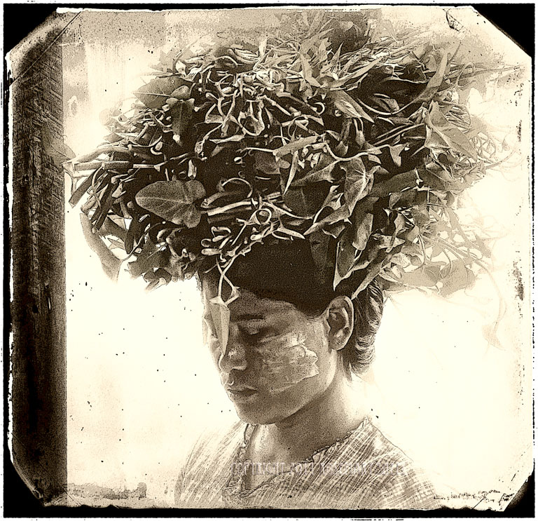 Burmese woman with flowers on her head