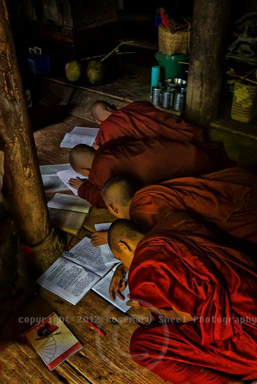 Buddhist Monks in Myanmar copy dictation from the Master