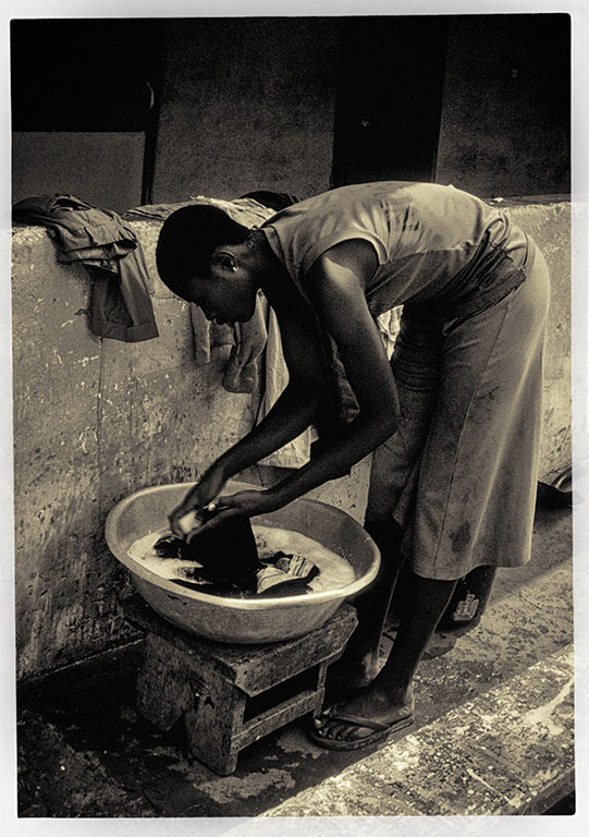 Beautiful young woman washing clothes in Togo West Africa