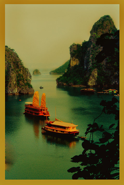 Two junks anchor in a cove of Ha Long Bay
