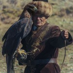 Hunter with his eagle perched on his arm