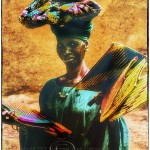 portrait of woman selling fans in Mopti Mali