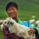 Tibetan girl with pashmina goat