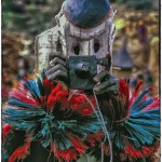 A Dogon man imitates a white tourist in a masked dance.