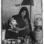 a Berber woman pours tea