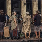 Women stand at the entrance to Moscow's subway with home made items for sale.