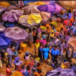 A Digital painting of the colorful Grand Market in Lome filled with Madam Benzes and a policewoman or two.