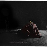 man prostrates himself before a statue of Buddha in a Buddhist temple in Ladakh