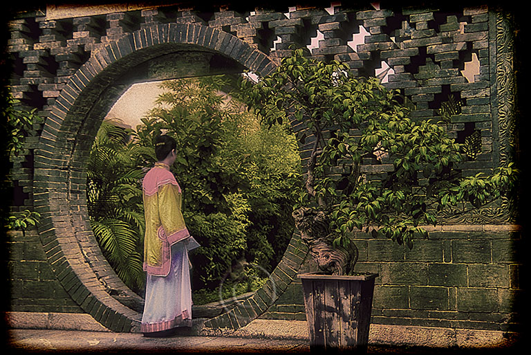 Chinese Woman In A Formal Garden With Moon Gate Travel