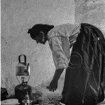 Rissani: a Berber woman prepares to make tea